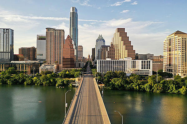 the city skyline of Austin, Texas with a bridge in the middle