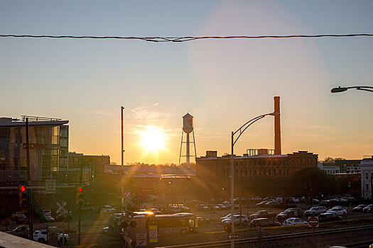 view of Durham, NC with a water tower at sunset