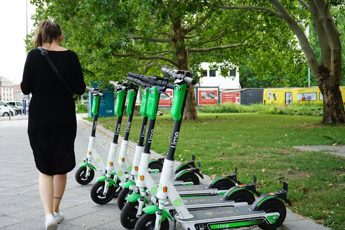 Woman-walking-past-scooters